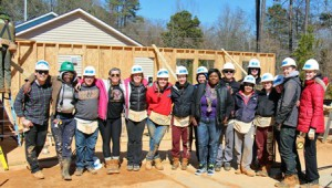 Emily Polanowicz (fourth from left) with her team, is ready to tackle her construction project for Habitat for Humanity in Raleigh, N.C.