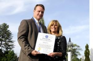 State Senator Michael Moore, D-Millbury, presents Deborah Penta with a proclamation from the State Senate.