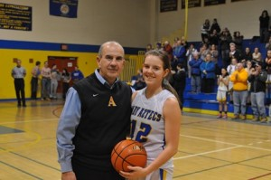 Katrina Joubert with Coach Frank Ferreer after scoring her 1,000th point at Assabet Valley Regional Technical High School. (Photo/submitted)