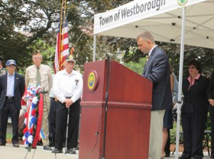 Westborough Veterans Advisory Board Chairman Brent French speaks in front of the Forbes Municipal Building.