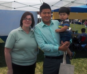 Kate Shaw, Central One Federal Credit Union branch manager poses with Jay Wang, who is holding Mason Chen.